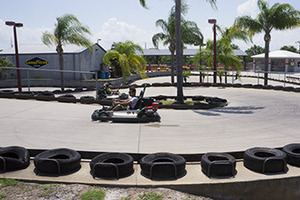Picture of Andretti theme park where a child is racing go-karts against others for fun.