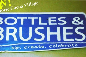 picture of Bottles and rushes advertisement. Sip. Create. Celebrate.
