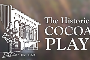 Picture of an old looking building with text saying the history of cocoa